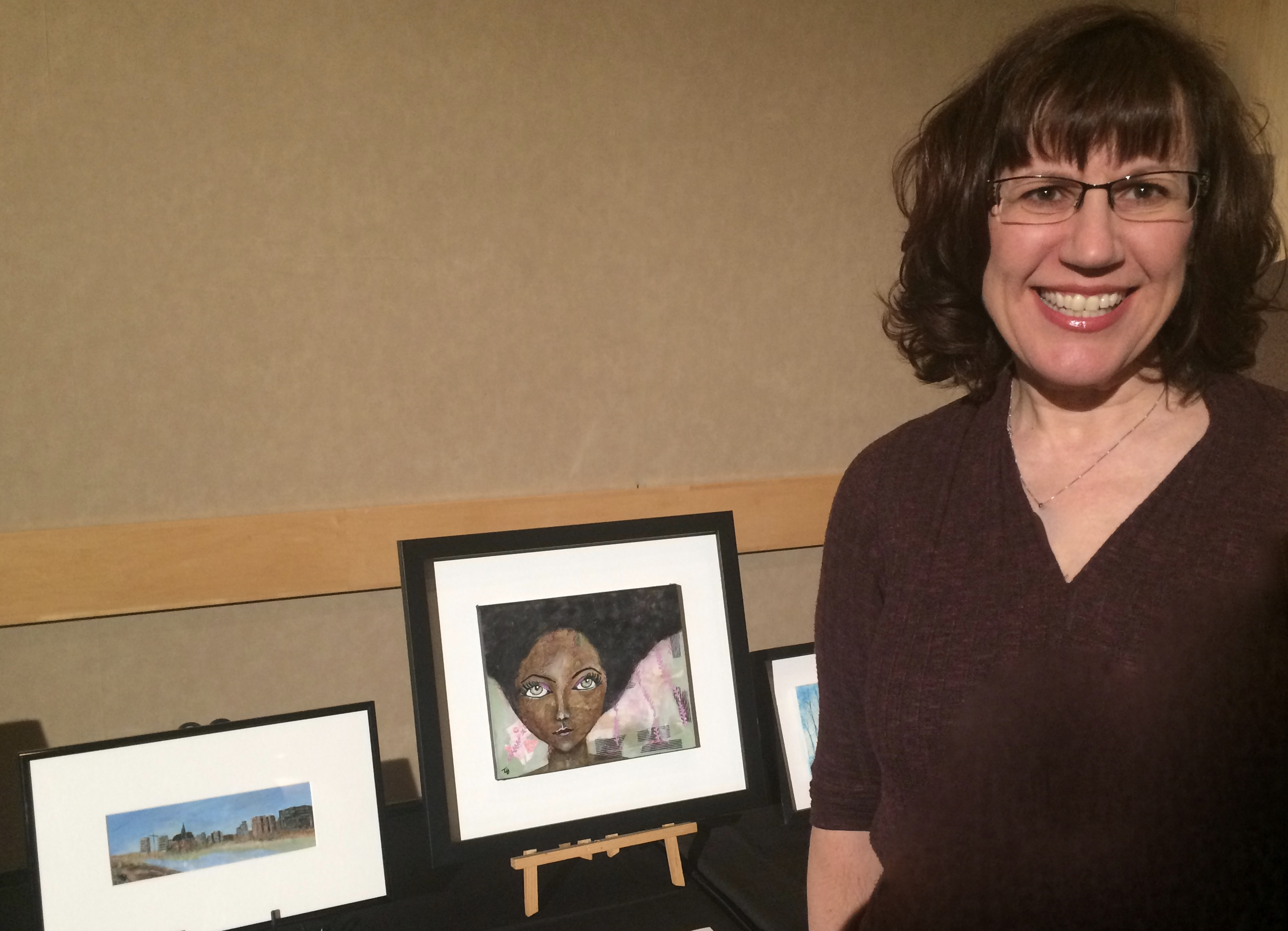 "Tammy with 2 of her paintings sold at the ""Artists Against Hunger"" auction in March, 2018"